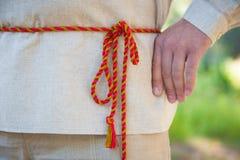 Folk belt on shirt Royalty Free Stock Image