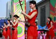 Folk concert of China. In a theatrical performance of 08 Beijing Olympic 100-day countdown in China,aeveral actresses are playing the erhu music.Erhu is a royalty free stock image