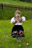 Folk costumes little girl on the meadow Royalty Free Stock Photo