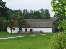 Folk cottage in the Austrian countryside Stock Photos