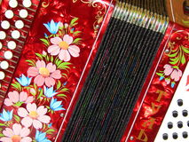 Folk crafts. National musical instrument.Russian harmonica. Royalty Free Stock Image