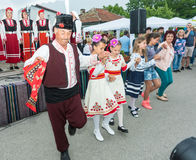 Folk dance of the elderly and children at the Nestenar Games in the village of Bulgarians, Bulgaria Stock Image