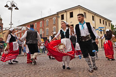 Folk dance ensemble from Calabria, Italy. The folk dance ensemble Irizema from Bova Marina, Calabria, Italy, performs traditional dance tarantella in the town stock photo