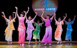 Folk Dance: Han girl play Stock Images