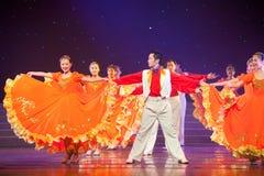 Folk Dance: Orange female and partner Stock Photo
