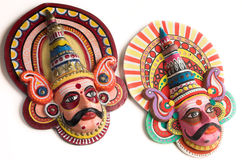 Folk dance puppets of India. Hand made face puppets/ masks depicting characters in yakshagana -- a folk dance form of southern India. Isolated on white royalty free stock photos