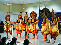Folk dance Yakshagana's performers on stage. Indian folk dance form, Yakshagana, being performed by a troupe of artists on stage, enacting a scene from Indian Stock Image