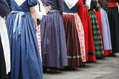 Folk dancer women. Group of folck dancer women in their colorful old dresses. Shallow DOF. Focus on left blue dress Royalty Free Stock Photo
