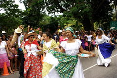 Folk dancers on carnival street. Royalty Free Stock Photography