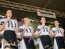 Folk dancers in traditional costumes royalty free stock photography