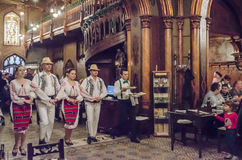 Folk dancers in traditional restaurant Royalty Free Stock Image