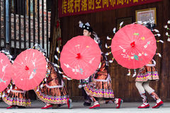Folk dancers with umbrellas in Dong Culture Show Royalty Free Stock Images