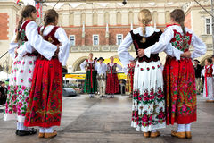 Folk dancers. Young Polish folk dancers dressed in traditional polish costumes Stock Images