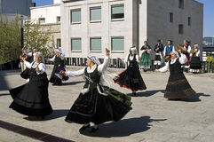 Folk dancing women, city Vigo, Spain Stock Photo