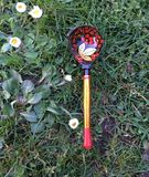 Folk Design Russian Khokhloma spoon. Russian Khokhloma Wooden spoon on grass background Royalty Free Stock Photography