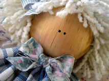 Folk Doll. A wood and cloth folk art doll stock photos