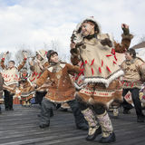Folk ensemble performance in dress of aborigine of Kamchatka. PETROPAVLOVSK, KAMCHATKA, RUSSIA - NOVEMBER 4, 2010: Folk ensemble performance in dress of Stock Photo