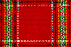 Folk fabric. Red folk fabric with frame royalty free stock image