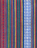 Folk fabric. Vintage folk fabric in bright colours stock images