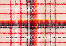 Folk fabric. In warm colors stock photography
