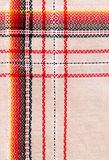 Folk fabric. In warm colors stock photo