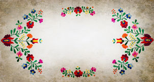 Folk frame. Embroidered folk background greeting card Stock Photos