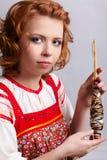 Folk girl with distaff Royalty Free Stock Photo