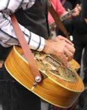 Folk Guitar Hero. A gentleman plays his folk guitar with a band at Washington Square Park Royalty Free Stock Images