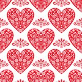 Folk heart vector seamless pattern, Scandinavian Valentine`s Day design with red hearts on white background Royalty Free Stock Photo