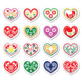 Folk hearts with flowers and birds icons set. Vector icons set of hearts isolated on white - folk art style Royalty Free Stock Photos