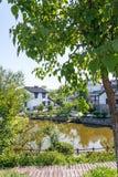 Folk house and lake stock image