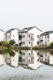 folk house and pond Stock Photos