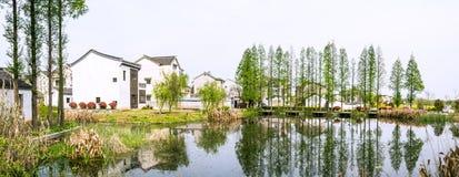 folk house and pond Stock Image