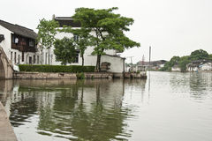 Folk houses on the riverside. The picture was taken at at ZHujiajiao, a historic town in suburbs of Shanghai, China. The folk house with white walls and black Royalty Free Stock Image