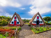 Folk Houses Santana village, Madeira. Traditional folk village with artistic cottage houses in Santana region of Madeira, Island of Portugal stock photos
