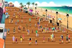 Folk i en strandpromenadplats arkivbilder