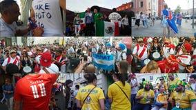 Folk i olika nationella kläder för fotbolllag lager videofilmer