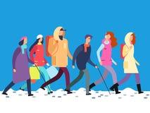 Folk i vinterkläder Tecknad filmman och kvinna, tonåringar som går i kall säsong royaltyfri illustrationer