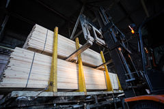 Folk lift truck in wood factory Royalty Free Stock Photos