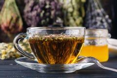 Folk medicine with honey and healing herbs concept Stock Photos