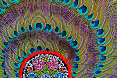 Folk motif decoration at one hat with peacock feathers Royalty Free Stock Photography