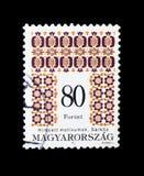 Folk motives of Sarkoz, Hungarian Folk Art serie, circa 1996. MOSCOW, RUSSIA - NOVEMBER 24, 2017: A stamp printed in Hungary shows Folk motives of Sarkoz Stock Photography