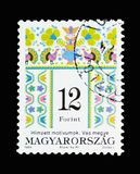 Folk motives of Vas County, Hungarian Folk Art serie, circa 1994. MOSCOW, RUSSIA - MARCH 18, 2018: A stamp printed in Hungary shows Folk motives of Vas County Stock Image