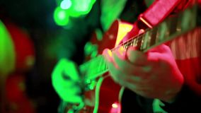 Folk music concert in a bar. Close ups of musicians playing acoustic folk music live on stage in a bar package of 5 scenes including guitar, trombone and violin
