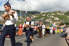 Folk music group in local costumes performs a folk dance at Madeira Wine Festival in Esterito de Camara de Lobos on the Madeira. Portugal. The Madeira Wine royalty free stock photo