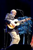 Folk Music with Paul Stookey. ST. PETERSBURG, FLORIDA - FEBRUARY 18, 2012: Paul Stookey, best known as Paul in the folk trio Peter, Paul and Mary, sings at The Royalty Free Stock Photography
