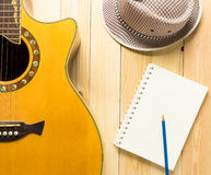 Folk music song writing equipments. On wooden table Royalty Free Stock Image