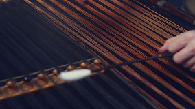 Folk musical instrument. Cimbalom music playing. String instruments background stock video