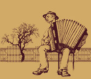 Folk musician. Accordion player plaing in street Royalty Free Stock Photo