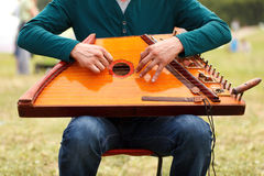 Folk musician playing gusli Royalty Free Stock Photo